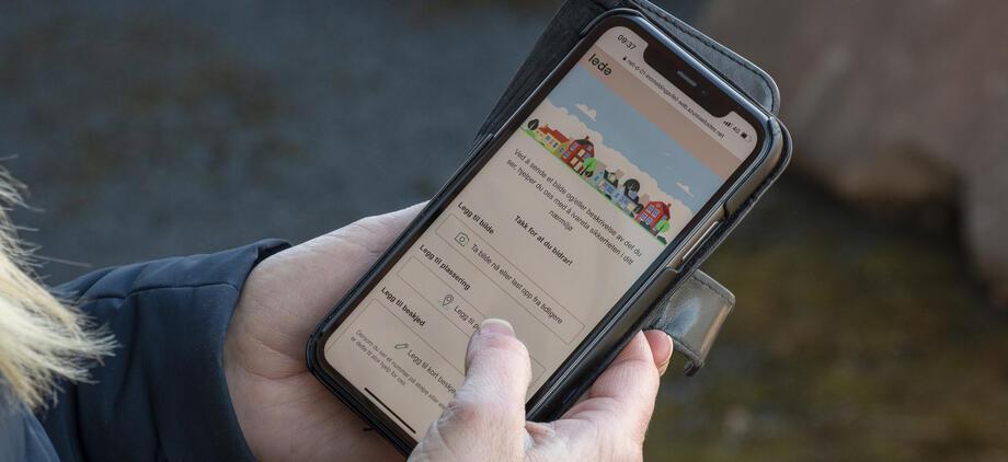 Mobiltelefon skjermbilde hånd